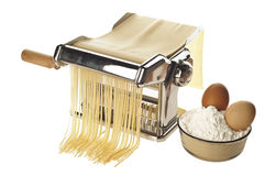 Pasta machine with fresh spagheti Stock Photo