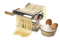 Pasta machine with fresh spagheti Stock Photo