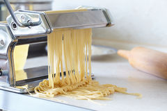 Pasta maker with noodles Royalty Free Stock Images