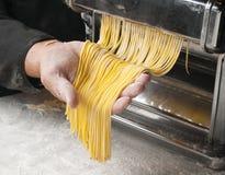 Pasta manual machine. Fresh pasta manual machine production handmade royalty free stock image