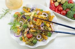 Pasta meal cooked with vegetables with fresh vegetables served w Stock Photography