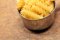 Pasta in measuring cup Royalty Free Stock Photo