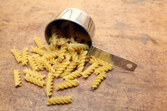 Pasta in measuring cup Stock Photos