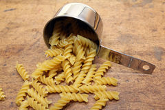 Pasta in measuring cup Royalty Free Stock Image