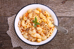 Pasta with meat and beans in a white bowl Royalty Free Stock Images