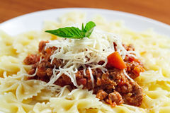 Pasta  meat cheese and garnish with mint. Royalty Free Stock Photos