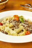 Pasta with meat, cherry tomatoes and cheese Royalty Free Stock Photo