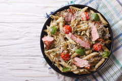 Pasta with meat, parmesan, tomatoes and pesto. Horizontal top vi Stock Images