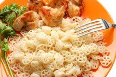 Pasta, meat and parsley on orange plate Royalty Free Stock Photography