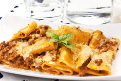 Pasta with meat sauce and bechamel Stock Photos