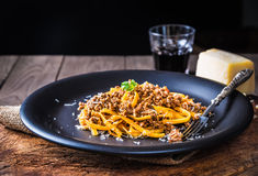 Pasta with meat sauce or pasta with ragu bolognese. Pasta with meat sauce or pasta with  ragu bolognese on rustic wood background.Italian food Stock Images