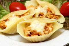 Pasta with meat. Pasta shells stuffed with meat Shallow DOF royalty free stock photos