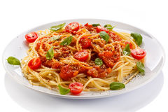 Pasta with meat, tomato sauce, parmesan and vegetables Stock Images