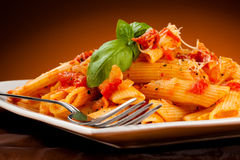 Pasta with meat, tomato sauce, parmesan and vegetables Royalty Free Stock Image