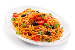 Pasta with meat, tomato sauce, parmesan and vegetables Stock Photo