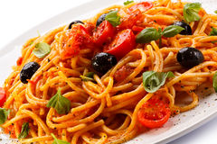Pasta with meat, tomato sauce, parmesan and vegetables Royalty Free Stock Images