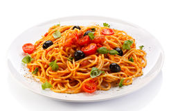 Pasta with meat, tomato sauce, parmesan and vegetables Stock Photos