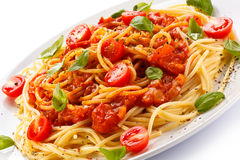 Pasta with meat, tomato sauce, parmesan and vegetables Stock Image