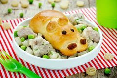 Pasta with meat and vegetables, fun bun in the shape of cute hip Stock Photo