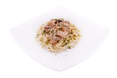 Pasta with meat on a white plate. Isolated Royalty Free Stock Photo