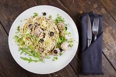 Pasta with meatballs, anchovies and olives. Royalty Free Stock Images