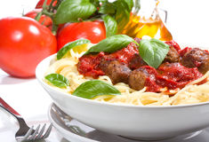 Pasta with meatballs and basil Stock Photography