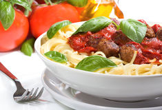 Pasta with meatballs and basil Stock Photo