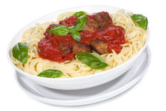 Pasta with meatballs and basil with tomato sauce Royalty Free Stock Images