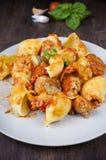 Pasta with meatballs. Lumaconi pasta with meatballs in tomato sauce rustica Stock Image