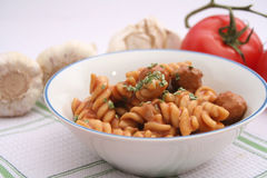 Pasta with meatballs and mushrooms Stock Image