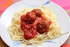 Pasta with meatballs. Some italian pasta with a sauce of tomatoes and meatballs Stock Images