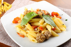 Pasta with meatballs, tomato and basil. On complex background Stock Image
