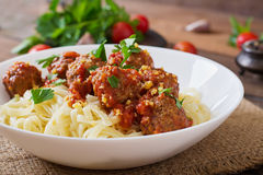 Pasta with meatballs in tomato sauce. Stock Photo