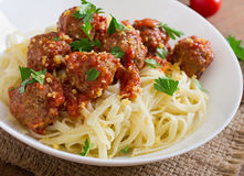 Pasta with meatballs in tomato sauce. Stock Image