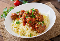 Pasta with meatballs in tomato sauce. Royalty Free Stock Image