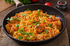 Pasta with meatballs in tomato sauce. Stock Images