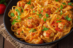 Pasta with meatballs in tomato sauce. Stock Photo