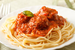 Pasta with meatballs. Traditional pasta with meatballs in white plate, close up Royalty Free Stock Images