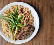 Pasta with meatloaf and green beans. Pasta meatloaf green beans lunch dinner meal food protein carbohydrates royalty free stock photo