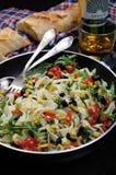 Pasta med oliv och tomater Royaltyfri Foto
