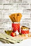 Pasta med tomaten, vitlök och olivolja Fotografering för Bildbyråer