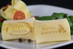 Pasta med trevlig bokstäver Arkivfoto