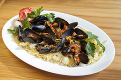 Pasta with Mediterranean mussels Stock Images