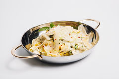Pasta in metal bowl Royalty Free Stock Images