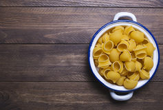 Pasta on metal container. Copy space. Stock Photography