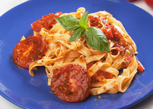 Pasta milanese with basil and tomato Royalty Free Stock Image