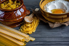 Pasta mix with ingredients on wooden background Stock Images