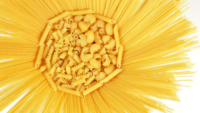 Pasta mix in sun shaped recipient isolated on whit Royalty Free Stock Photo