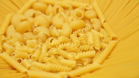 Pasta mix in sun shaped recipient isolated on whit Stock Photos