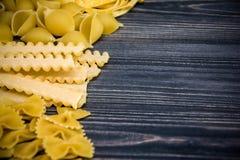 Pasta mix on wooden background Stock Photo